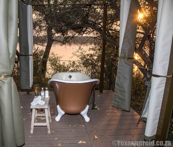 Outdoor clawfoot bath, Old Drift Lodge, Victoria Falls