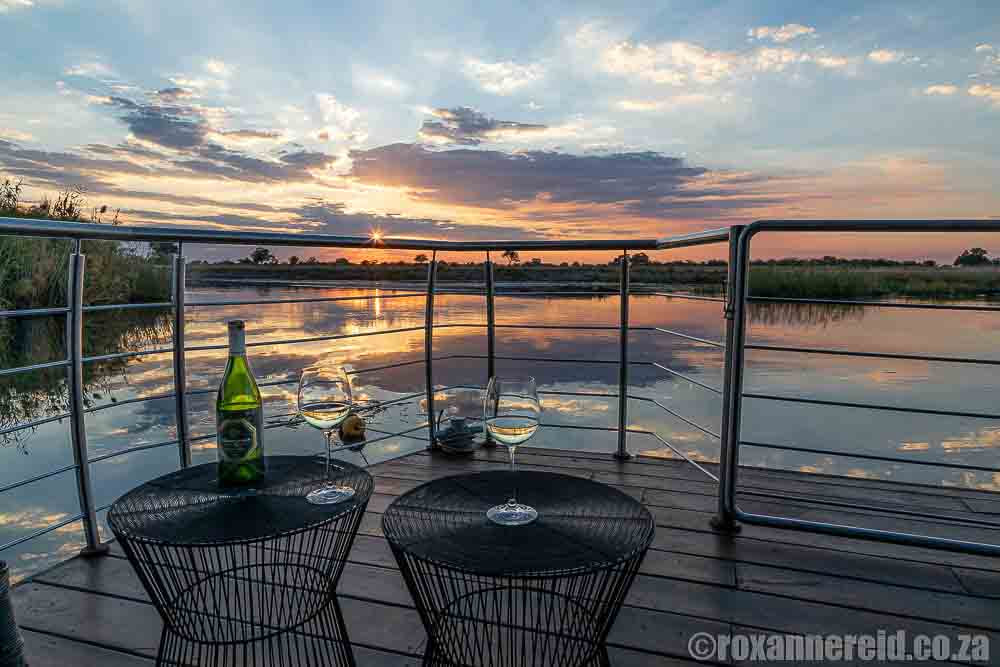 Where to stay Namibia: sunset from Namushasha River Villa, Zambezi houseboat